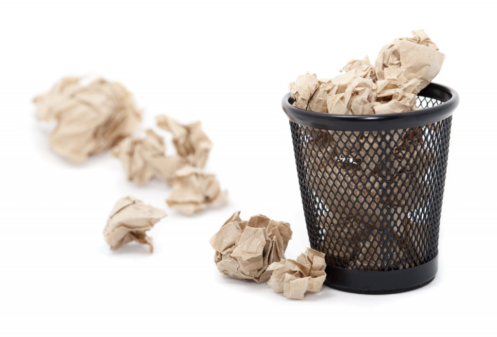 Wastepaper basket with crumpled paper